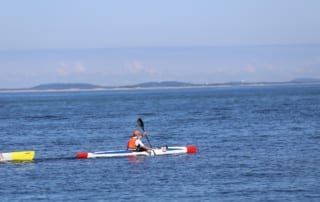 Surf skis in open water race
