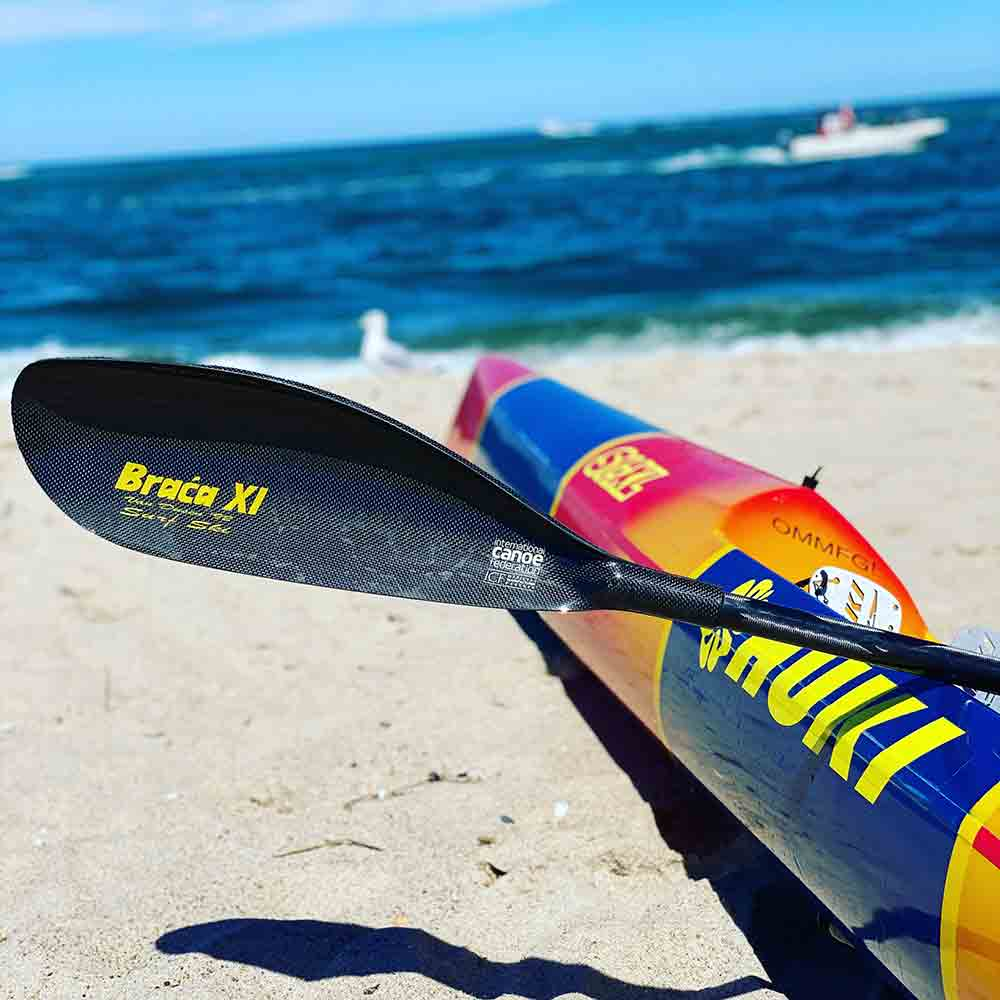 Braca XI Surfski paddle on Cape Cod beach in front of a Surfski